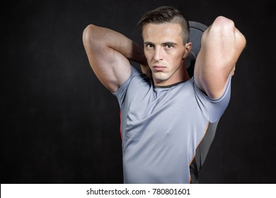 Bodybuilder with equipment portraits in studio