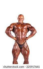 bodybuilder flexing his muscles isolated white