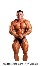bodybuilder flexing his muscles in studio