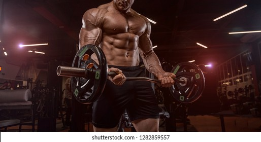 Bodybuilder in the gym doing the exercise