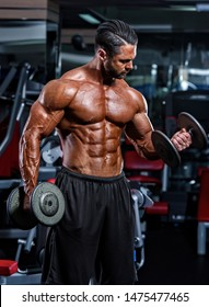 Bodybuilder Lifting Weights, Performing Dumbbell Bicep Curls