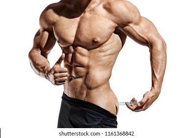 Bodybuilder makes an injection of vitamins. Photo of sporty man with perfect physique showing gesture like thumb up on white background. Close up. Strength and motivation