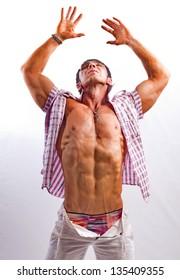 Bodybuilder man in a plaid shirt in the studio