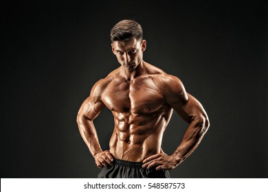 bodybuilder posing. Beautiful sporty guy male power. Fitness muscled man