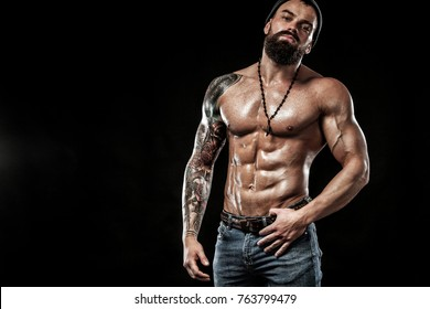 Bodybuilder posing. Beautiful sporty guy male power. Fitness muscled man. Spot concept with copy space