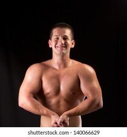 Bodybuilder posing in off season shape