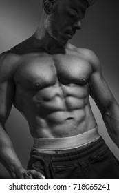Bodybuilder posing  on gray background