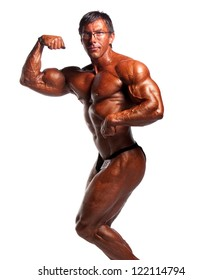 bodybuilder posing over white background