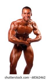 Bodybuilder posing ower white background