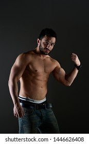 bodybuilder sexy turkish man on the black background with his sexy muscle nude body.