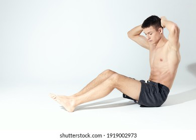 bodybuilder in shorts doing fitness in a bright room inflated torso