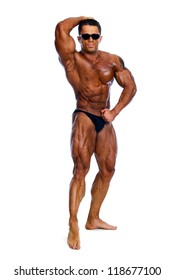 Bodybuilder showing his muscles on a white background