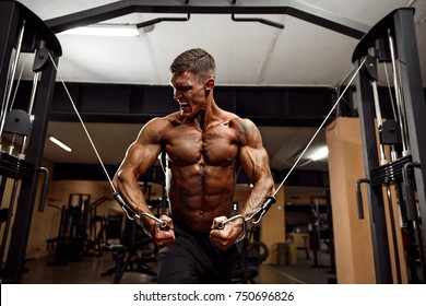 Bodybuilder Is Working On His Chest With Cable Crossover In Gym. Scream for motivation