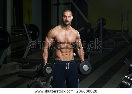 Bodybuilder Working Out Biceps