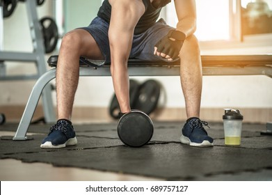 Bodybuilder working out with dumbbell weights at the gym.handsome power athletic man bodybuilder doing exercises with dumbbell. Fitness muscular body