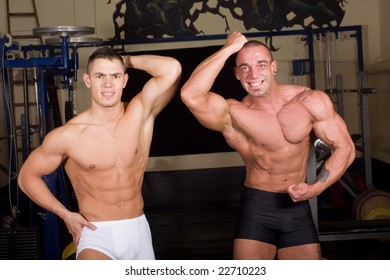 Bodybuilders posing in the gym