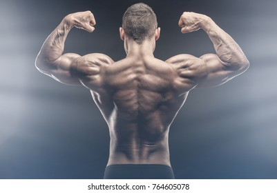 Bodybuilding. Athletic man shows his muscular back