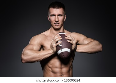 Bodybuilding. Attractive man with ball