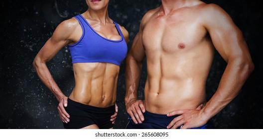 Bodybuilding couple against black background