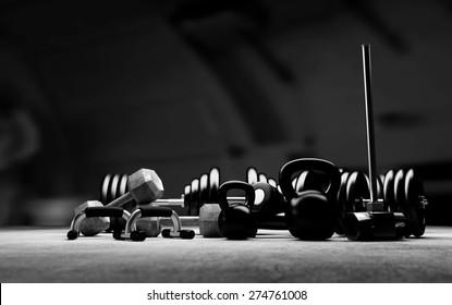 Bodybuilding equipment on concrete floor. Black and white illustration.
