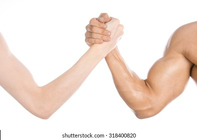 Bodybuilding & Fitness Topic: arm wrestling thin hand and a big strong arm isolated on white background in studio