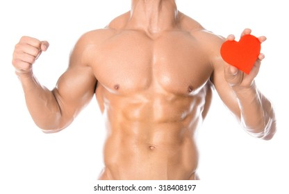 Bodybuilding and Health: handsome strong bodybuilder holding a paper card red heart isolated on a white background in studio