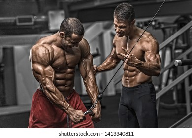 Bodybuilding Motivation. Two Bodybuilders Train Together at the Gym
