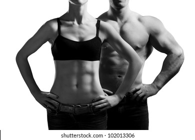 Bodybuilding. Strong man and a woman posing. Isolated on white background