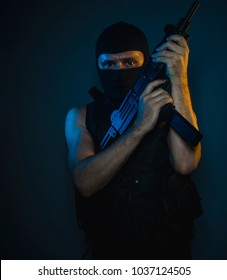 Bodyguard, hit man, armed and dangerous man with balaclava and bulletproof vest, concept killer contract