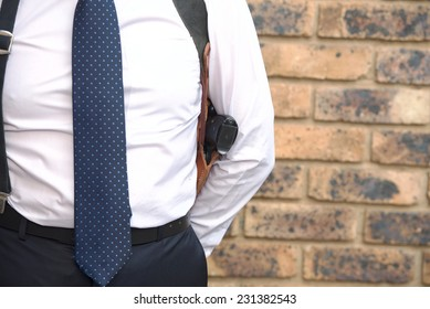 Bodyguard in a white shirt with a tie and a pistol