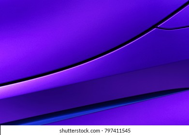 Bodywork of violet sedan, surface of sport car door and fender in ultramodern style, abstract detail of concept racing vehicle