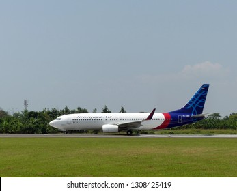 A Boeing 737 800 of Sriwijaya Air (reg. PK- CMN) when taxing at  Jenderal Ahmad Yani International Airport Semarang, Central Java, Indonesia,