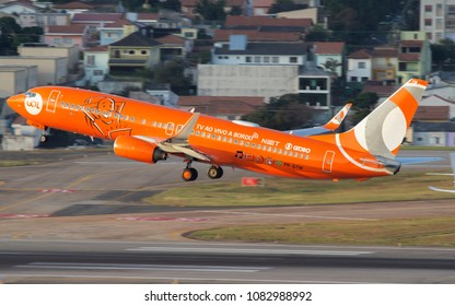 Boeing 737-800 of GOL Linhas Aereas with special orange livery of Live TV on board departure of Congonhas Airport in Sao Paulo, Brazil - 2018