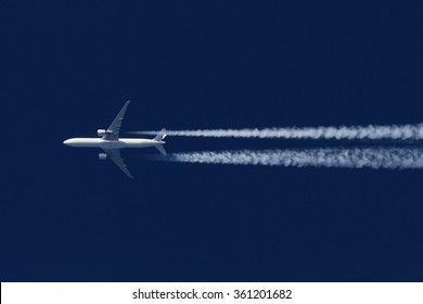 Boeing 777 civil airliner flying on high altitude.