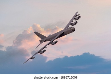 Boeing B52 Bomber of the United `states Airforce (USAF) at sunset. B-52 nuclear and heavy bomber banking towards the camera at sunset. B52s used in Afghanistan against Taliban targets in 2021