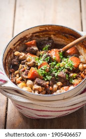 Boeuf bourguignon with carrots, mushrooms, topped with parsley