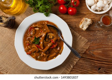 Boeuf, Stroganow, Strogonow. Classic, Russian beef stew. Served on a white plate.  Top view. Natural background.