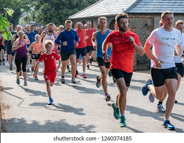 Bognor Regis, Sussex / UK - 26 May 2018: A weekly fun run in the local park attracts individuals, teams, walkers and runners. All ages participate in pursuit of a healthy lifestyle.
