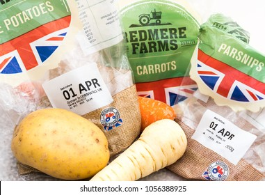 Bognor Regis, West Sussex / UK - March 28 2018: Fresh Redmere Farm vegetables from Tesco and unnecessarily packaged in plastic; aptly labelled 1st April or All Fools Day.