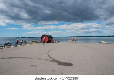 Bogo Denmark - June 30. 2018: People on the pier near the sauna at Skaaninge bro port on island of Bogo