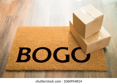 BOGO Welcome Mat On Wood Floor With Shipment of Boxes.