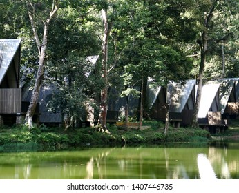 Bogor, Indonesia - May 23, 2019: Huts on Warna Lake or Telaga Warna in Puncak, Cisarua District, Bogor, West Java. Indonesia.