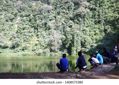 Bogor, Indonesia - May 23, 2019: Fishing at Warna Lake or Telaga Warna in Puncak, Cisarua District, West Java.