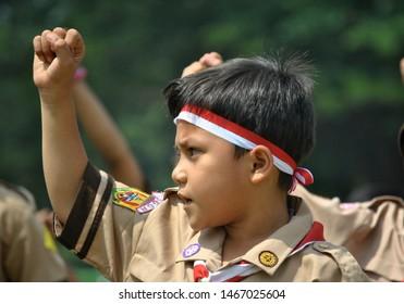 Bogor west java / Indonesia August 14, 2014 ; Indonesian scout dance with dancers carrying semaphore flags, dance, karate, egrang, hoola hoop.