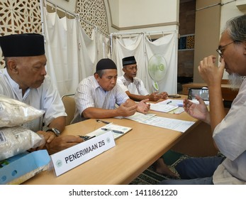 Bogor, West Java / Indonesia - May 27, 2019  : Receiving zakat fitrah by ZIS officer of Al - Falaah Mosque