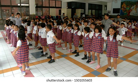Bogor, West Java, Indonesia - September 2019 : A group of kindergarten students in a hall with their teachers.