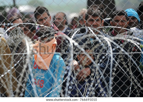 Bogorodica, Gevgelija, Macedonia, August 21 2015: Refugees and migrants stage a protest demanding to be allowed to cross to Macedonia, near the Macedonian village of Gevgelija.