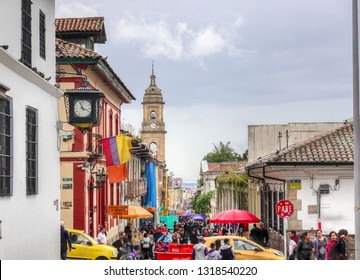 Bogota, Colombia - 10/21/2018   A view of a crowded street in La Candelaria neighborhood in Bogota. You see the crowds of people in the narrow street with the distinctive colonial architecture.
