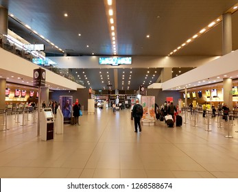 Bogota, Colombia. 12 23 2018. Interior or inside of the airport El Dorado in Bogota. with international tourist, people waiting forf the plane, signs of departure and arrivals of the flights.