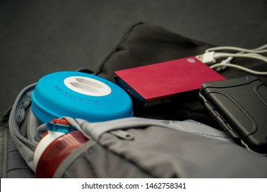 Bogota, Colombia - 25/07/2019: Stockphoto of bag surrounded by gadgets used for travelling (digital nomad)